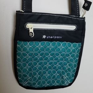 Sherpani teal black quilted crossbody bag prima